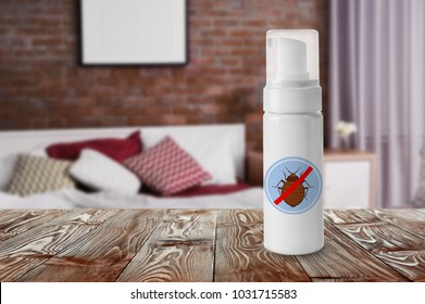 Bottle of anti bed bug detergent on table in bedroom
