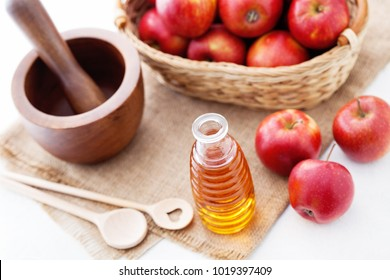 bottle of Apple cider vinegar with fresh fruits - food and drink