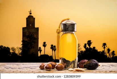 Bottle of argan oil and fruits for skin care with moroccan landscape on the background