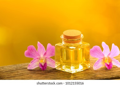 bottle of aroma essential oil or spa on wooden table, image for aroma spa alternative therapy medicine and meditation aroma concept.