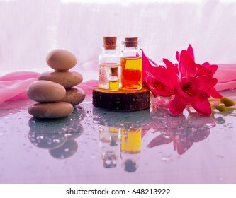 bottle of aroma essential oil or spa and natural fragrance oil with dry flower on wooden table, image for aroma spa alternative therapy medicine and meditation aroma concept.