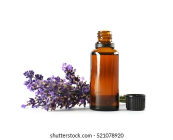 Bottle with aroma oil and lavender flowers isolated on white