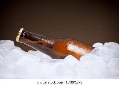 A bottle of beer buried on ice.