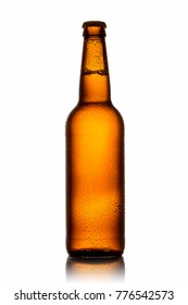 Bottle of beer with drops on white background.