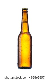 Bottle with beer and drops on white background