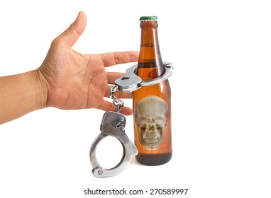 Bottle beer and handcuffs, concept for drinking and driving
