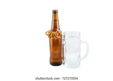 Bottle of beer with pretzels and goblet for beer isolated on white.