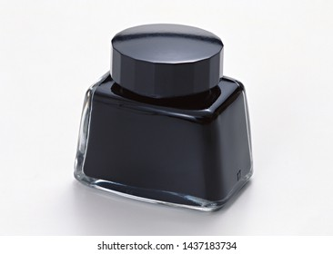 Bottle of black writing ink. Clipping path. Isolated on white background