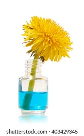 Bottle with blue liquid and yellow dandelion