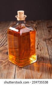 Bottle of brandy on a wooden table