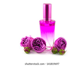 Bottle with cap of oriental natural perfume of rose water with three buds of pink rose on white background.