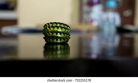 Bottle cap stacking over wooden dark table background.