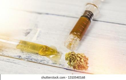 Bottle with CBD Cannabidiol, Cannabidiol full spectrum paste and hash
