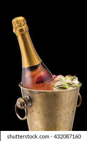 Bottle of Champagne in the bucket with ice closeup
