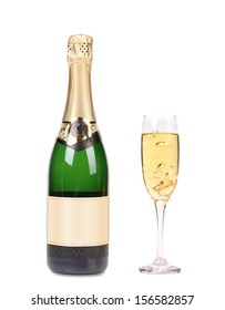 A bottle of champagne and full glass. Isolated on a white background.