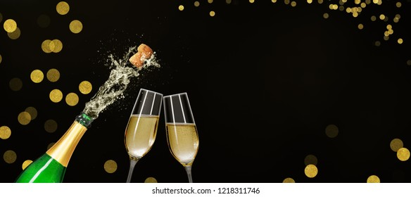 Bottle with champagne glasses and copy space