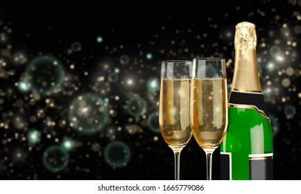 A bottle of champagne and glasses on background with lights
