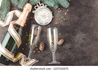 Bottle of champagne and glasses on black background. Concept New Year.