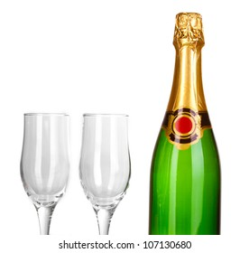 Bottle of champagne and goblets isolated on white