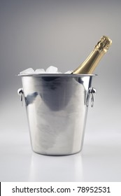 A bottle of champagne in a  ice bucket