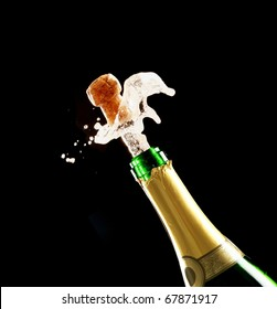 Bottle of champagne just opened with cork being expelled