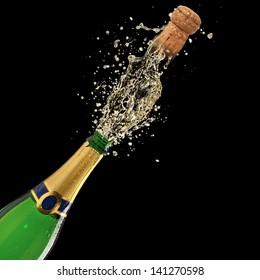 Bottle of champagne with splash on black background