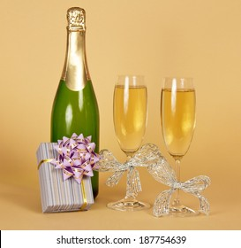 Bottle of champagne and wine glasses