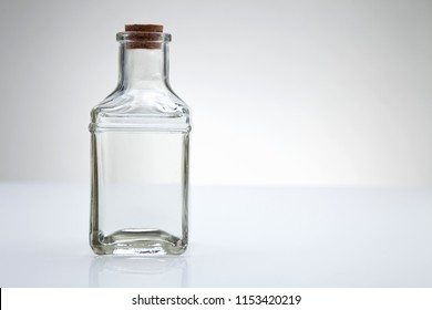 bottle of clear liquid on the white background