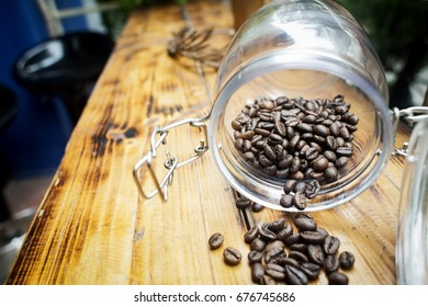A bottle of coffee beans on wooden table