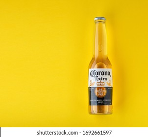 Bottle of Corona Extra Beer. On yellow background. Corona is made in Mexico and is the top selling imported beer in the United States. 13.03.2020, Russia.