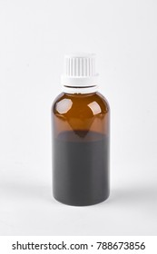 Bottle with cough syrup, white background. Medical liquid in glass brown bottle on white background, front view.