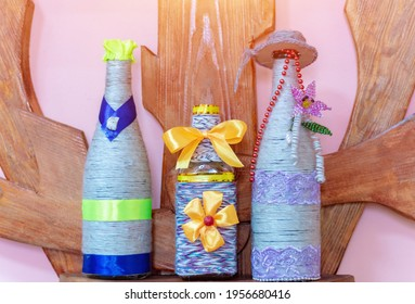Bottle decorated with a rope. Handmade.