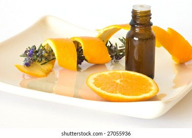 bottle of essence oil with orange and rosemary