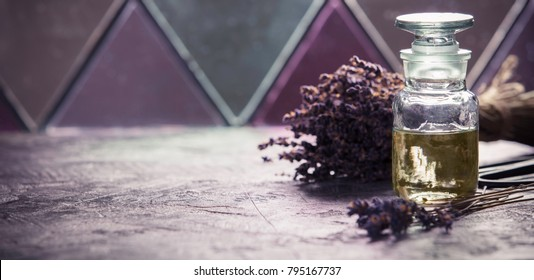 Bottle of Essential Lavender Oil for Aromatherapy. Lavender Spa concept. Natural pure lavender oil or scented water in bottles for spa, skin care or aromatherapy