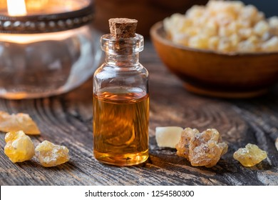A bottle of essential oil with frankincense on a table