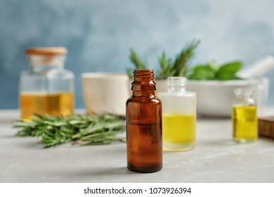 Bottle with essential oil on table