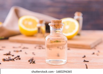 Bottle with essential oil on wooden table