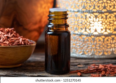 A bottle of essential oil with red sandalwood