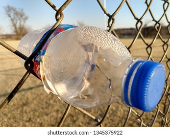 Bottle in the Fence