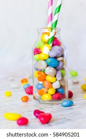 Bottle filled with colorful candies