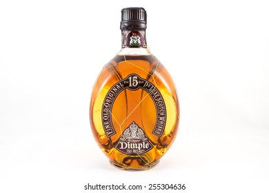 A bottle of fine and rare 15 years old Dimple de Luxe Scotch James Whiskey. Illustrative editorial, the photo was taken on February 22, 2015 in Porto, Portugal