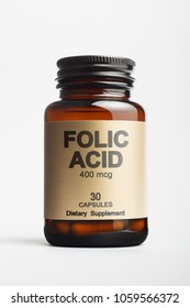 Bottle with folic acid supplement on white background