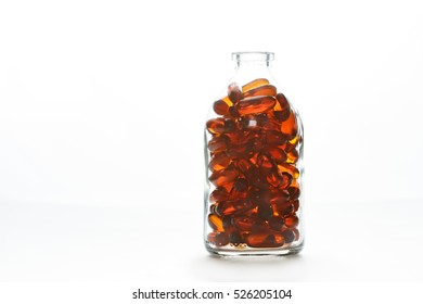 Bottle with gelatin capsules on white background. Fish oil, omega 3-6-9 dietary supplement.