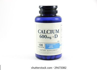 A bottle of generic Calcium with Vitamin D used for bone health isolated on a white background.