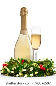 Bottle and glass of champagne with christmas decoration on white background