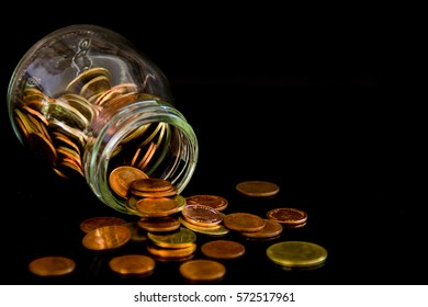 bottle glass and coins on black  background