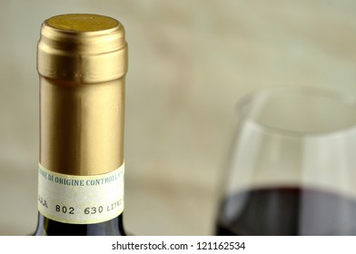Bottle and glass of fine italian red wine, closeup