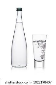 Bottle and glass with healthy sparkling  water lemonade with bubbles on white