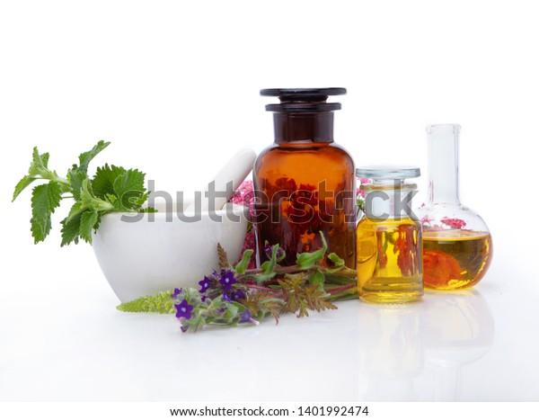 Bottle, glass of herbal extract - alternative medicine.