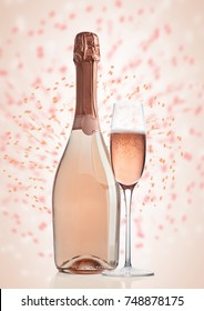 Bottle and glass of pink rose champagne with new year celebration background